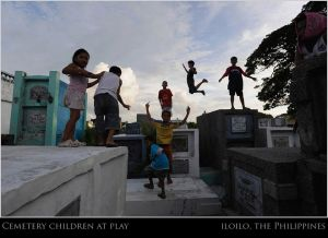 Children in Emilda\'s backyard play a dangerous game of tombstone jumping.